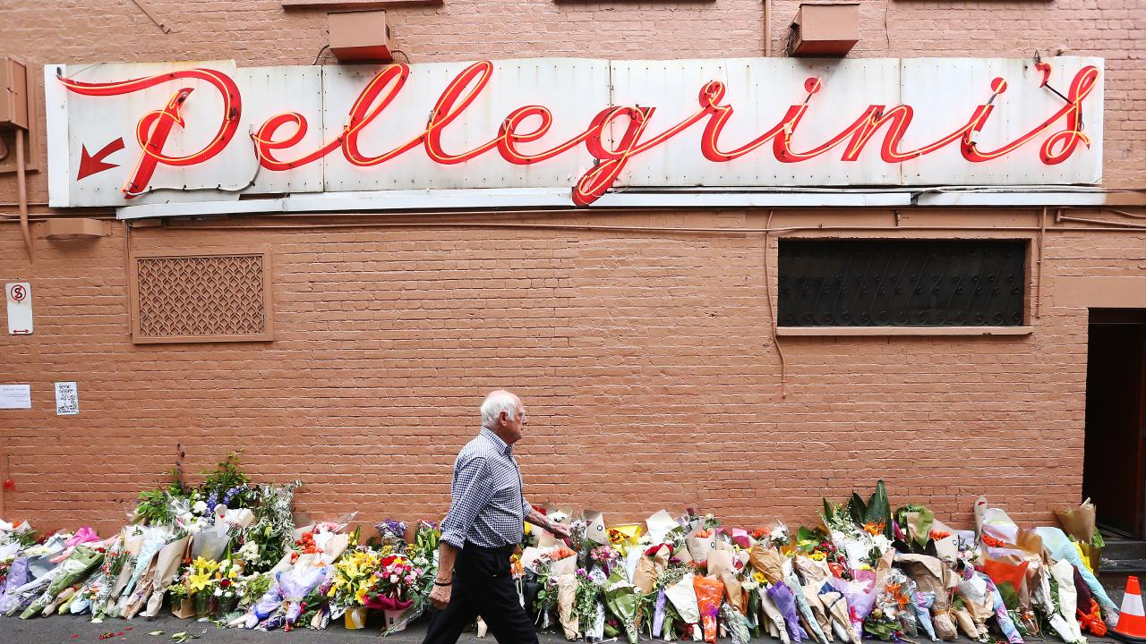 Floral tributes rest outside Pellegrini's cafe in Bourke St after co-owner Sisto Malaspina was killed by Hassan Khalif Ali in this month's terror attack in Melbourne.