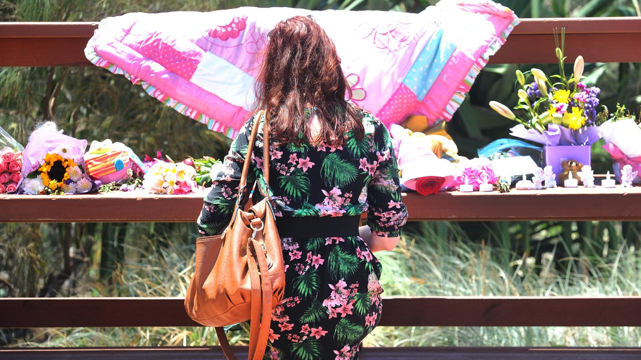 A woman pays her respects at a tribute to the baby girl found dead in Surfers Paradise. Picture: AAP