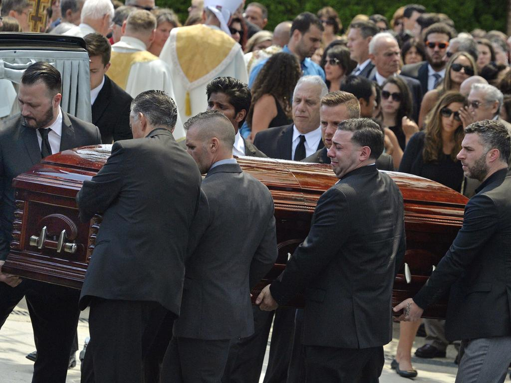 Mourners carry the coffin of Karina Vetrano during her funeral in New York in August, 2016. Picture: AP