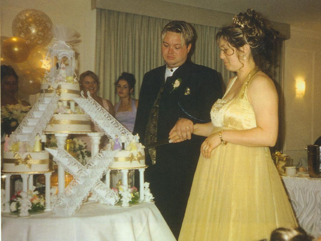 Carl and his pregnant wife Roberta Mercieca cut their cake. Picture: Big Shots/Adam Shand/Penguin