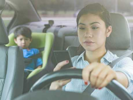School pick up time saw a massive spike in drivers using their phones. Picture: iStock
