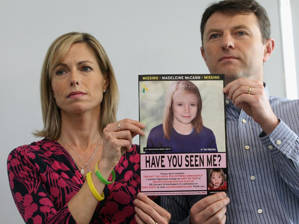 Kate and Gerry McCann hold an age-progressed police image of their daughter during a news conference to mark the 5th anniversary of the disappearance of Madeleine McCann, on May 2, 2012 in London, England. Picture: Getty