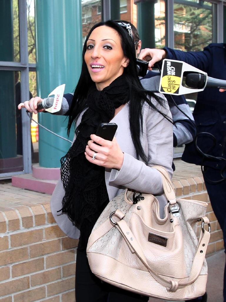 Fiancee Susie Arida leaves court after finding Sam could attend his wedding.