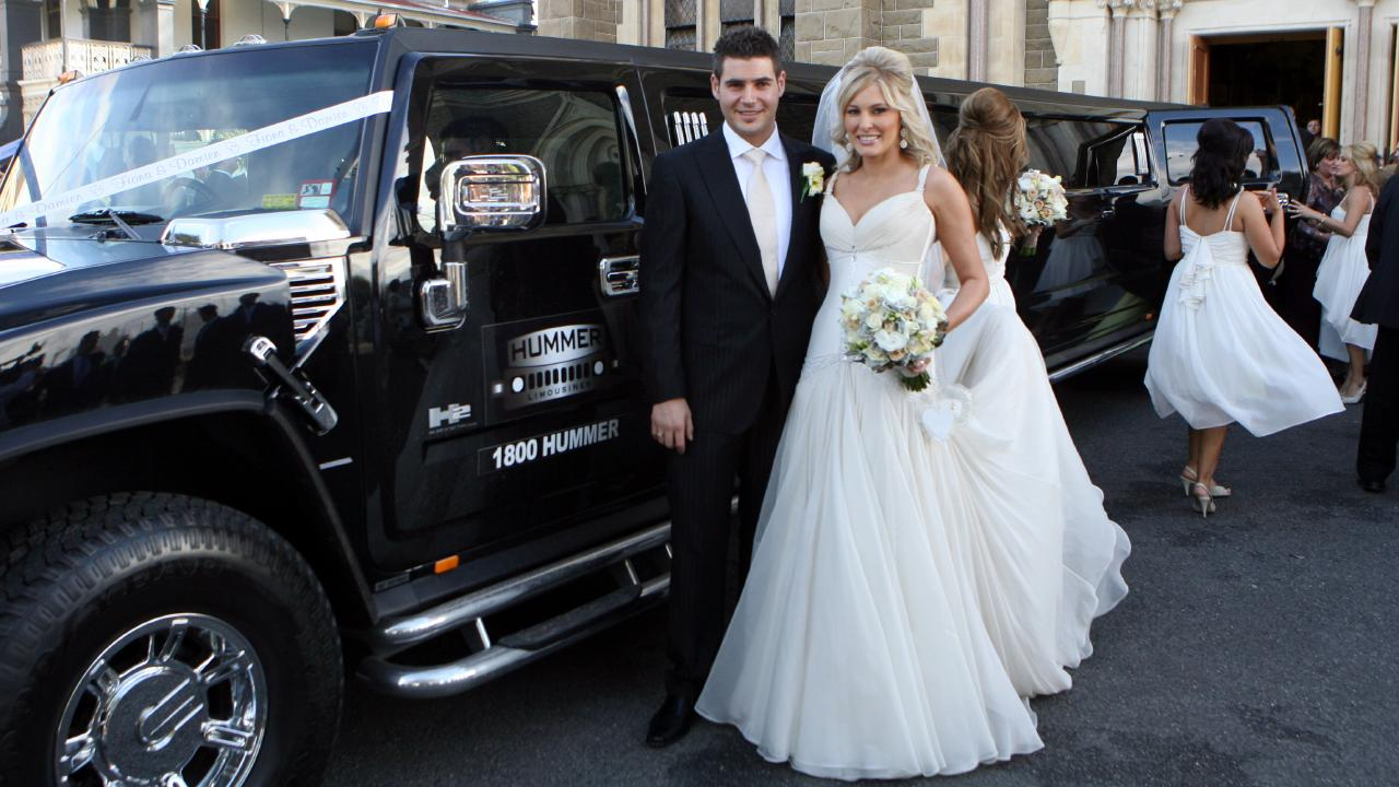 Damien Gatto and his bride Fiona Scali outside St Mary Star of the Sea Catholic Church in West Melbourne.