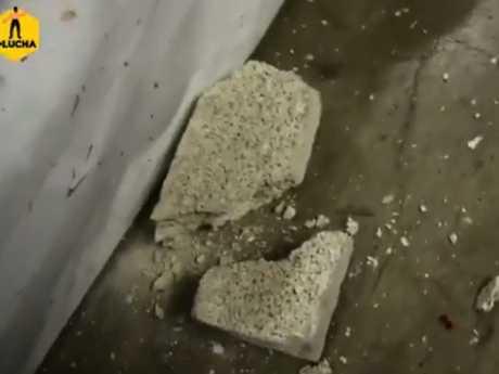 The brick split in two.