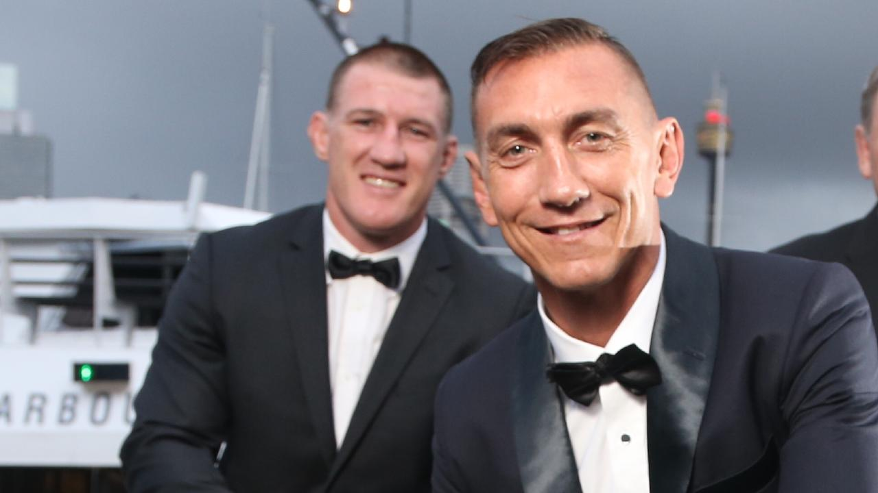 Mat Rogers, front, has hit back at Paul Gallen, back, over his comments on Valentine Holmes.