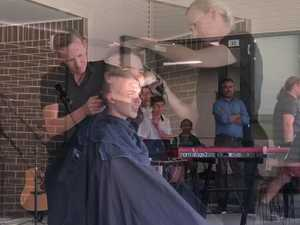 Local girl shaves her head for cancer