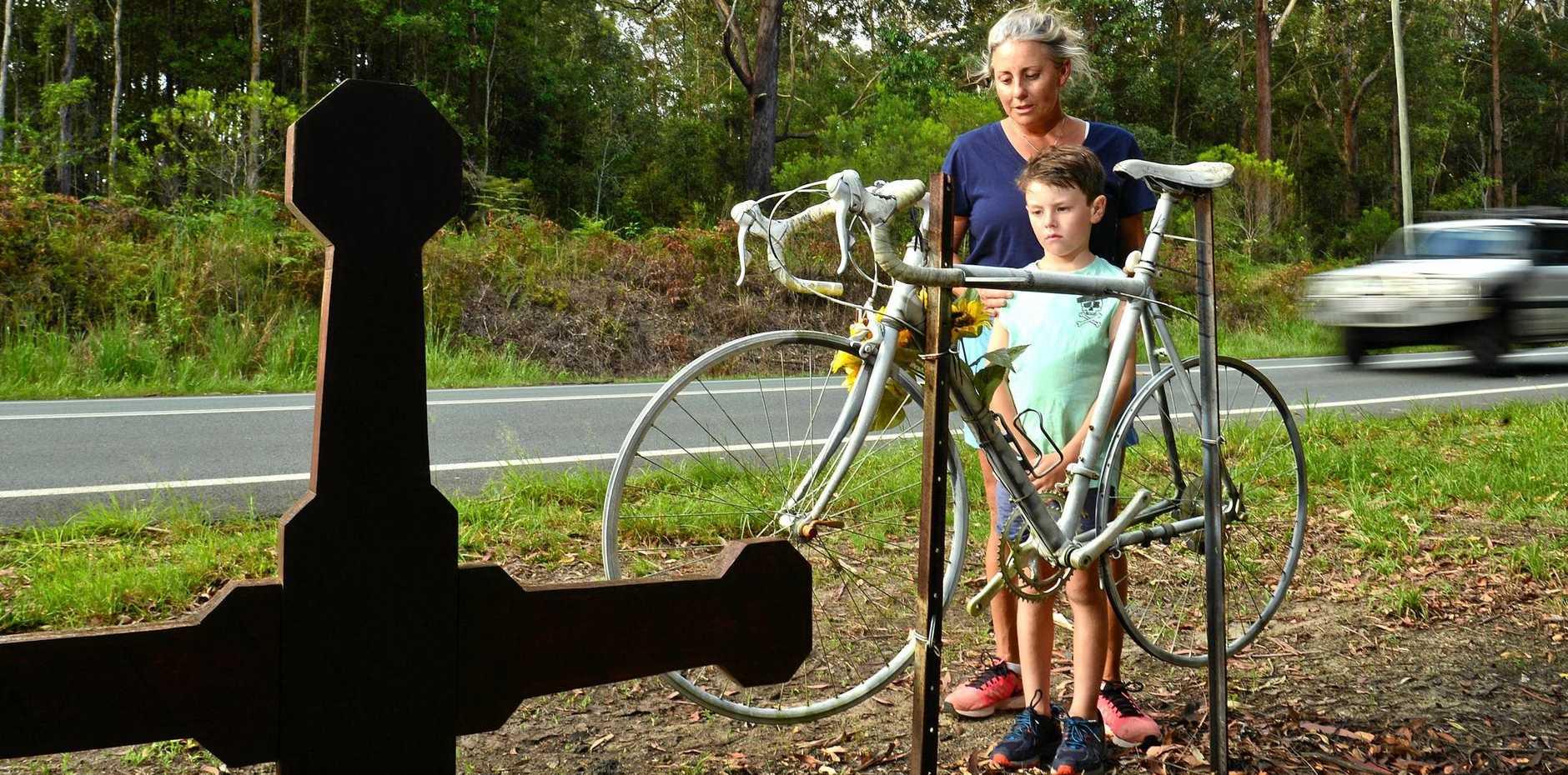 Yolanda Brady and her son Oscar Small at the memorial site in Doonan.