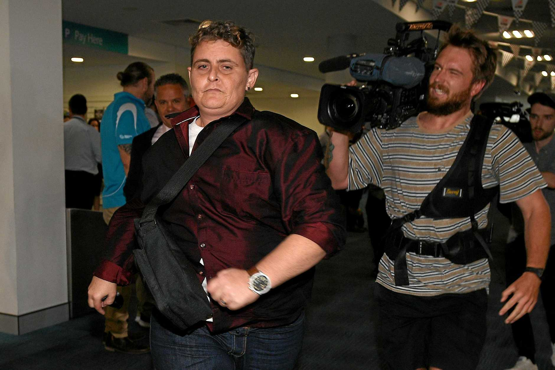 Bali Nine drug smuggler Renae Lawrence runs through the terminal as she arrives at Newcastle airport, on Thursday, November 22, 2018. Lawrence was released from Indonesia's Bangli Prison yesterday after spending more than 13 years behind bars for attempting to smuggle 2.7kg of heroin from Bali to Australia.