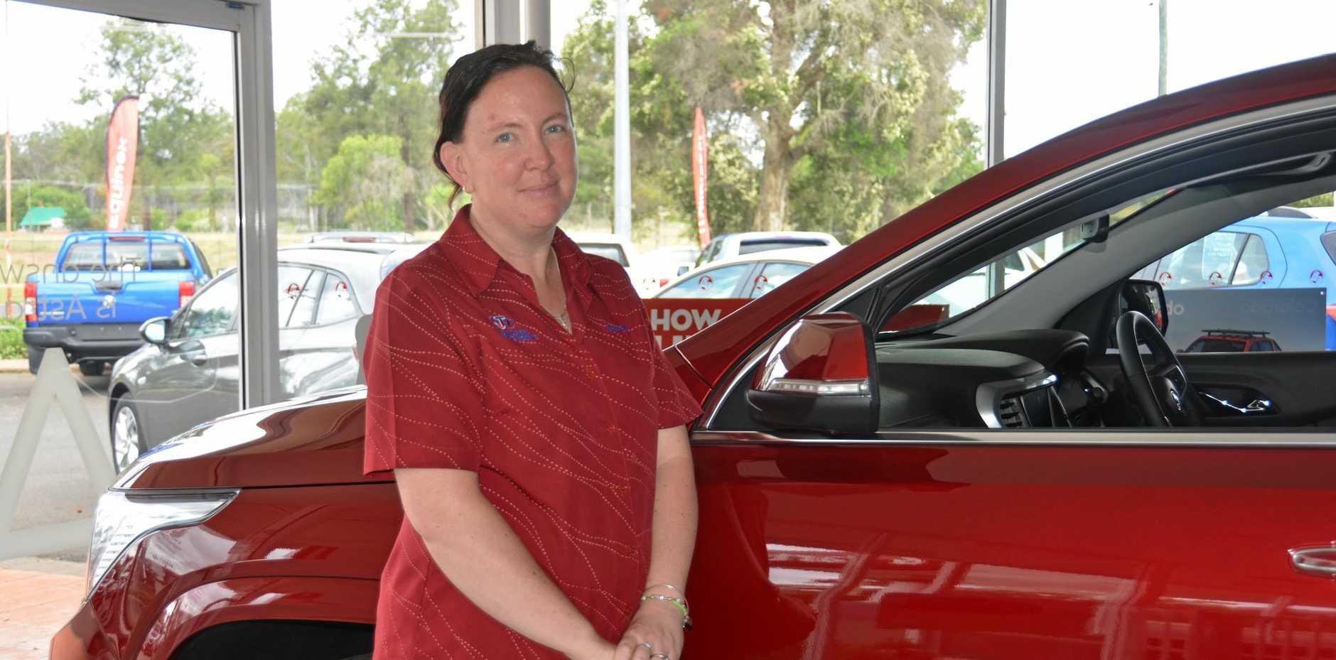 Sharon Davey showing off the new Acadia SUV at John Dundas