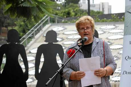 Domestic Violence Death Review Action Group member Betty Taylor speaks at an anti-domestic violence rally.