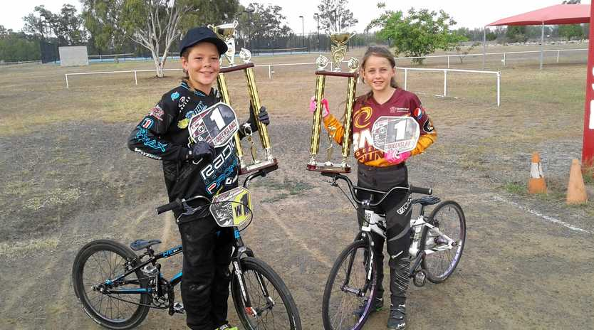 TROPHY TRAVELS: Callide Valley BMX Club members Tama Onekawa and Abby Stevens didn't come home empty handed from State Championships in September.