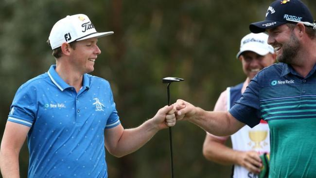 Cameron Smith and Marc Leishman celebrate another birdie.