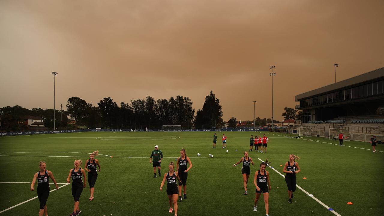 Dust storm across western Sydney as Matildas coach Alan Stajic puts the Sydney Swifts netballers through their paces in an off-season training session at Valentine Park, Glenmore. Picture: Phil Hillyard