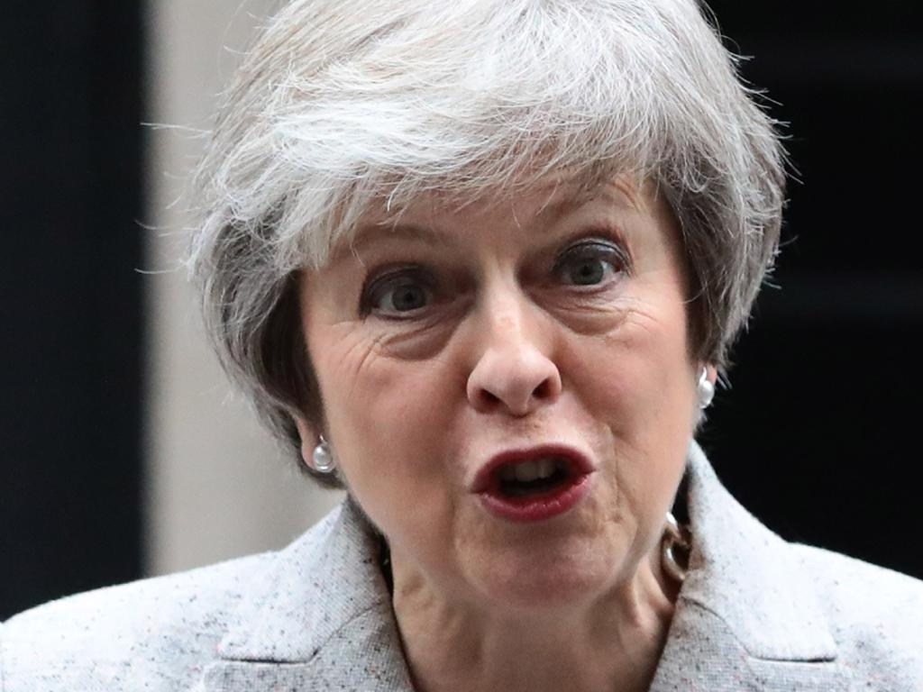 Theresa May wins leadership challenge after vowing to fight efforts to oust her.
