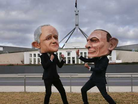 Two protesters wearing large heads of the Prime Minister Malcolm Turnbull and former Prime Minister Tony Abbott on the lawns of Parliament House in Canberra. Picture: Gary Ramage