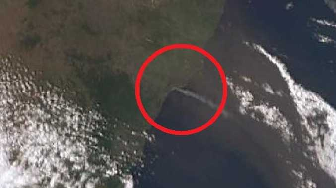 The fire can be clearly seen north of Newcastle on satellite imagery. Picture: Bureau of Meteorology