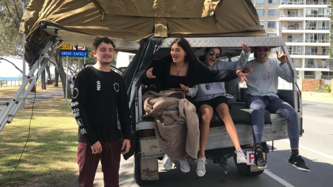 Owner of the ute Jordan Thomas, 17, with his friends Jaydee Wilson, 16, Paige Jack-Kino, 16, and Lawson Ittensohn, 17, spent the night cuddled up in the ute tray with two more friends still asleep above. Photo: Emily Halloran