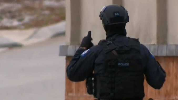 Armed police are on the scene in Ellenbook, Perth. Picture: Channel 9.