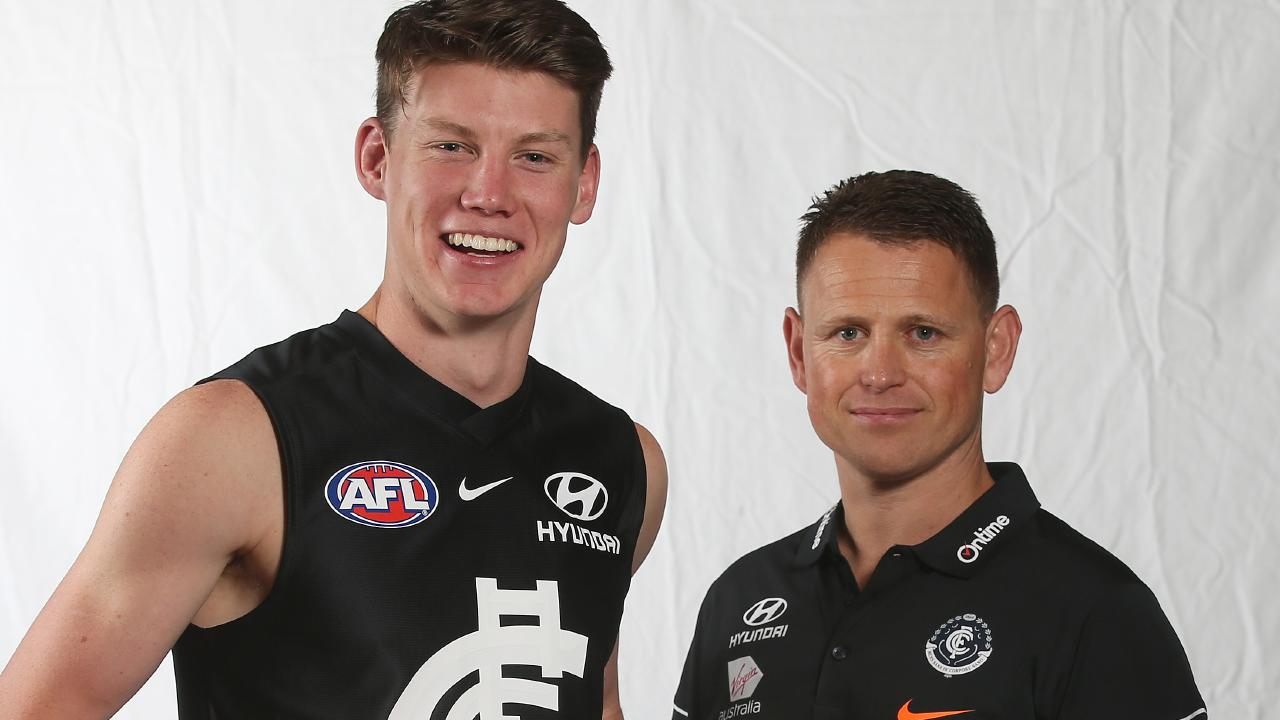 No.1 pick Sam Walsh with Carlton coach Brendon Bolton. Picture: Michael Klein