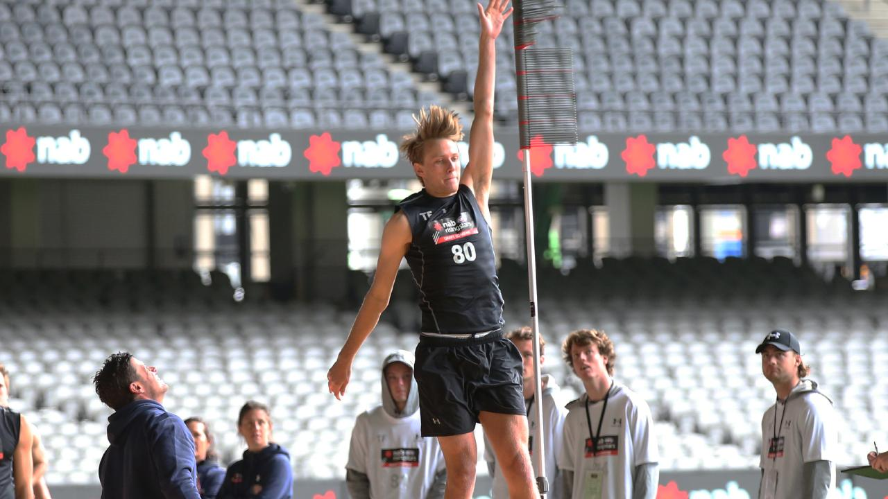Jack Lukosius of the Woodville West Torrens attempts a vertical leap test during the 2018 AFL Draft Combines at Marvel Stadium in Melbourne, Thursday, October 4, 2018. (AAP Image/David Crosling) NO ARCHIVING