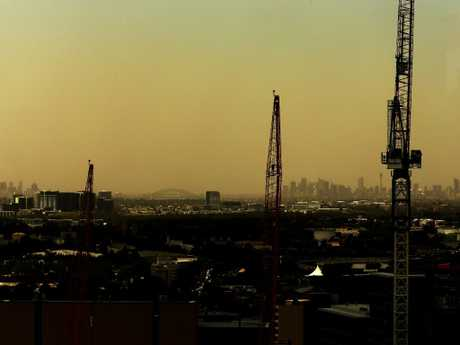 The dust over the Sydney CBD as seen from Parramatta as the storm approached. Picture: Jonathan Ng