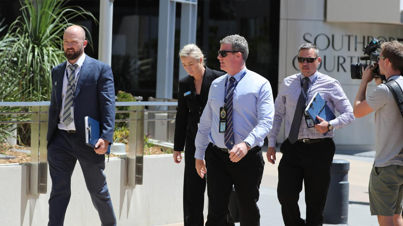 NSW and Queensland police detectives at Southport Court. The extradition from Queensland to New South Wales of a father accused of killing baby girl that washed up on a Surfers Paradise beach. Picture: NIGEL HALLETT
