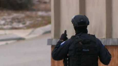 Armed police surrounded the home in Ellenbook, Perth. Picture: Channel 9.