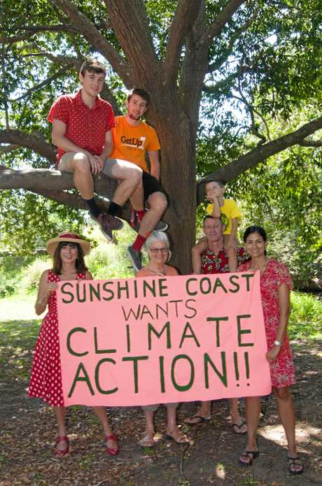 Cameron and Kendall Jones (in tree) with Camille Edwards, Dartanyon Hutchison, Phoebe Young, Peter Edwards, Keryn Jones and Vivien Griffin supporting the Sunshine Coast Climate Action Rally.