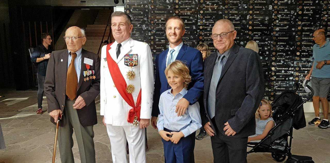 FOUR GENERATIONS: Harry Wadleigh was presented with a French Legion of Honour Medal at the war memorial in Hyde Park Sydney. The revered Royal Navy war veteran on the left is pictured with the French Grand Chancellor, his grandson Joel, great grandson Louie at the front and son Rick on the far right.