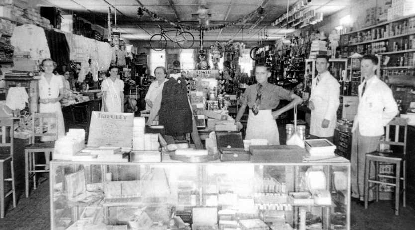 Staff standing at the front of Tytherleigh's General Store in Bulcock Street, Caloundra, ca 1920.