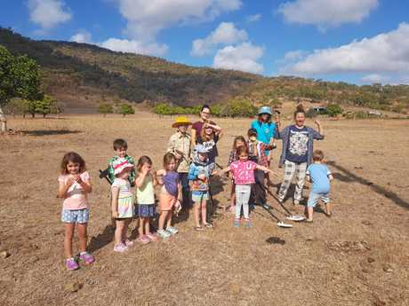 HEART OF GOLD: A group of children about to go fossicking at Targinnie.