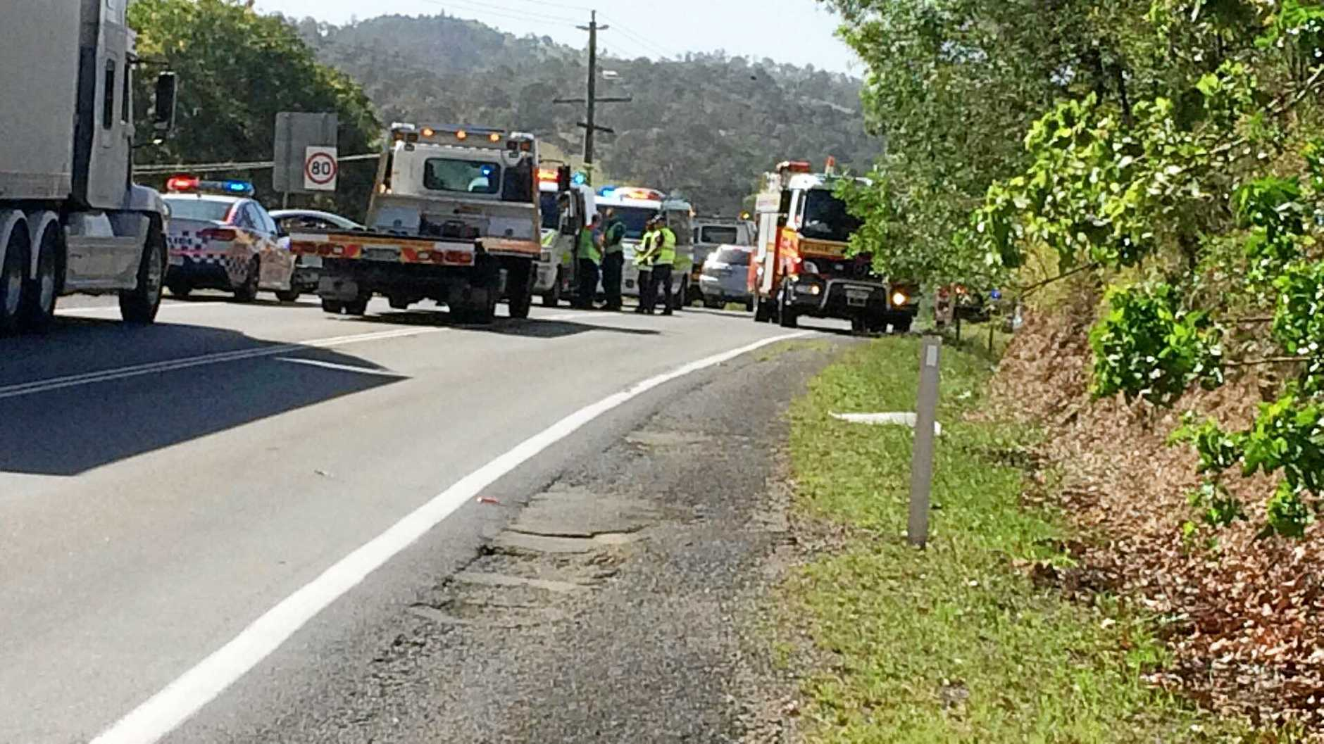 Emergency services work to clear a car crash on the Bruce Highway at Chatsworth.