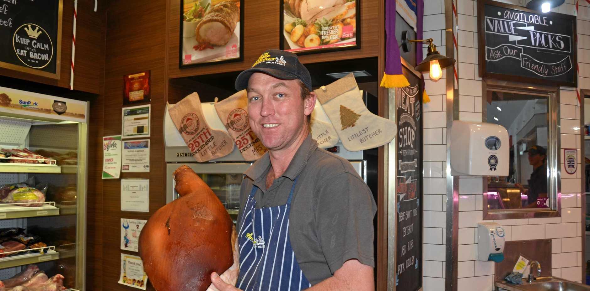 Clinton Stretton parades a Christmas ham prepared by his team at The Little Butcher