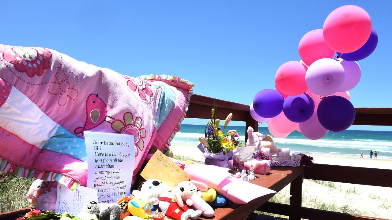 Tributes at the Surfers Paradise beach where a baby was found dead. (AAP image, John Gass)
