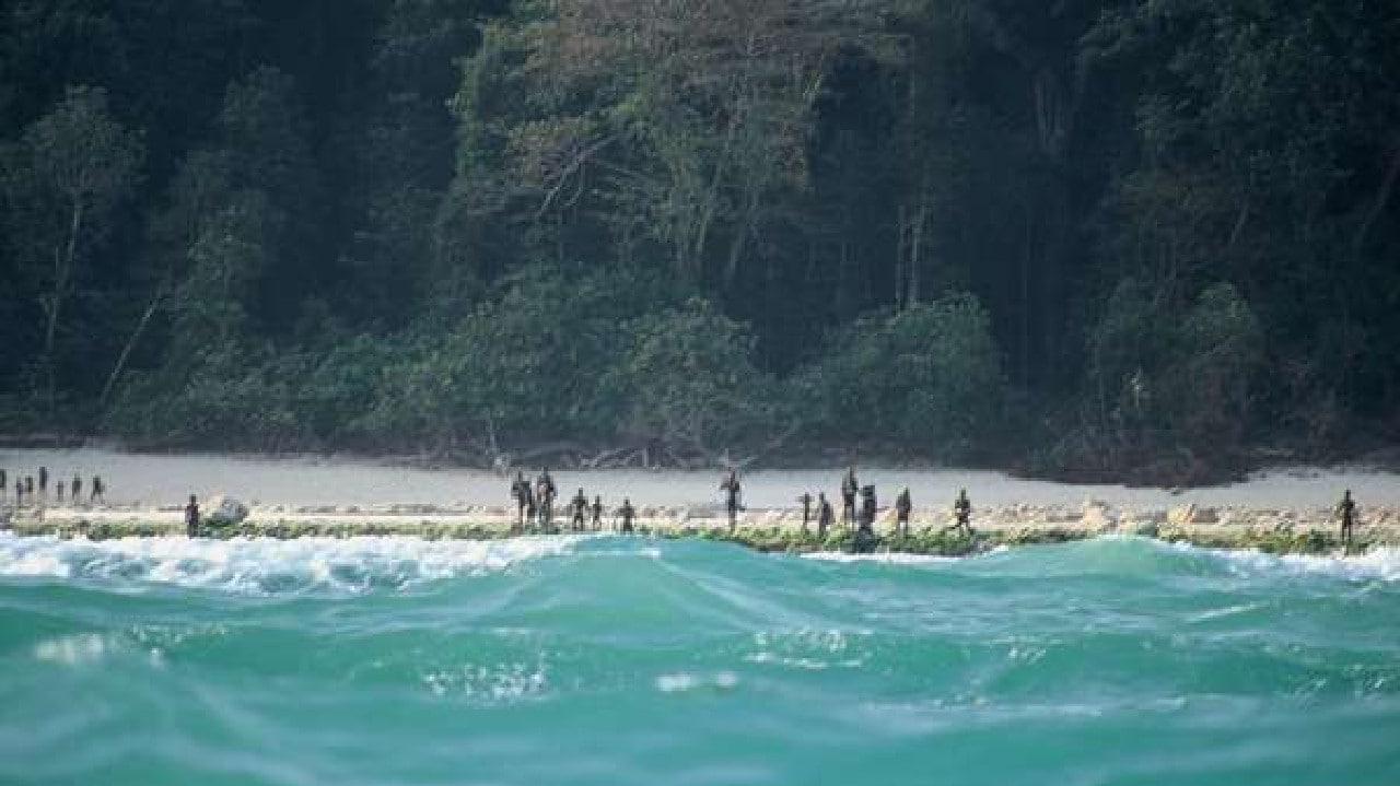 The Sentinelese stand guard on an island beach. Picture: Christian Caron — Creative Commons A-NC-SA