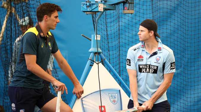 Pat Cummins speaks to Steve Smith at NSW training on Thursday. (Photo by Cameron Spencer/Getty Images)