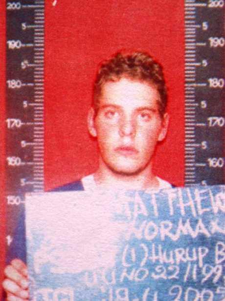 Arrest photo of baby-faced Matthew Norman, 18.