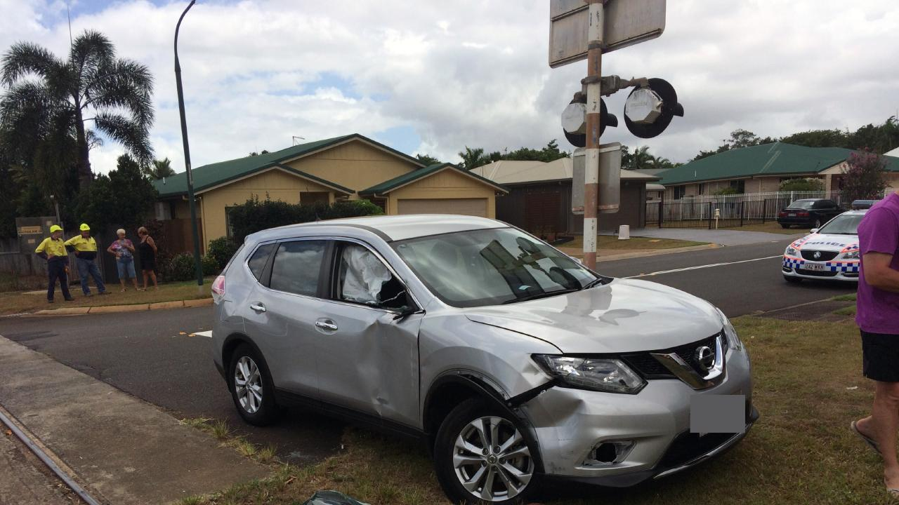 A wrecked car after it collided with a sugar train on a level crossing in Cairns.