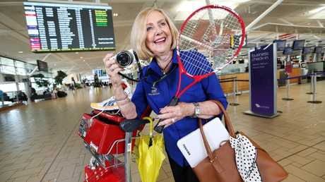 Bev Stephens with a bunch of items ahead of Brisbane Airport's lost property auction. Picture: Tara Croser