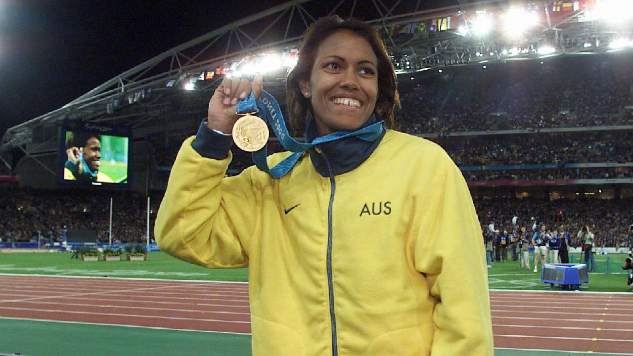 26/09/2000. Athlete Cathy Freeman of Australia on track wearing her gold medal after winning final of Women's 400m sprint. Stadium Australia, Homebush. 2000 Olympic Games. Sydney Olympics.