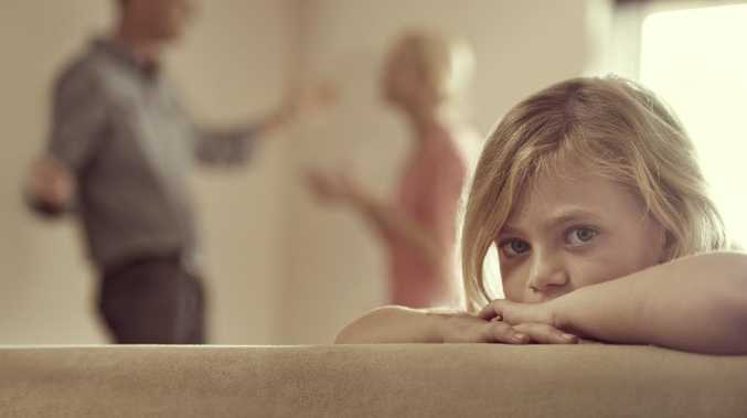 Domestic violence illustration — young girl listens to parents fighting. Picture: iStock
