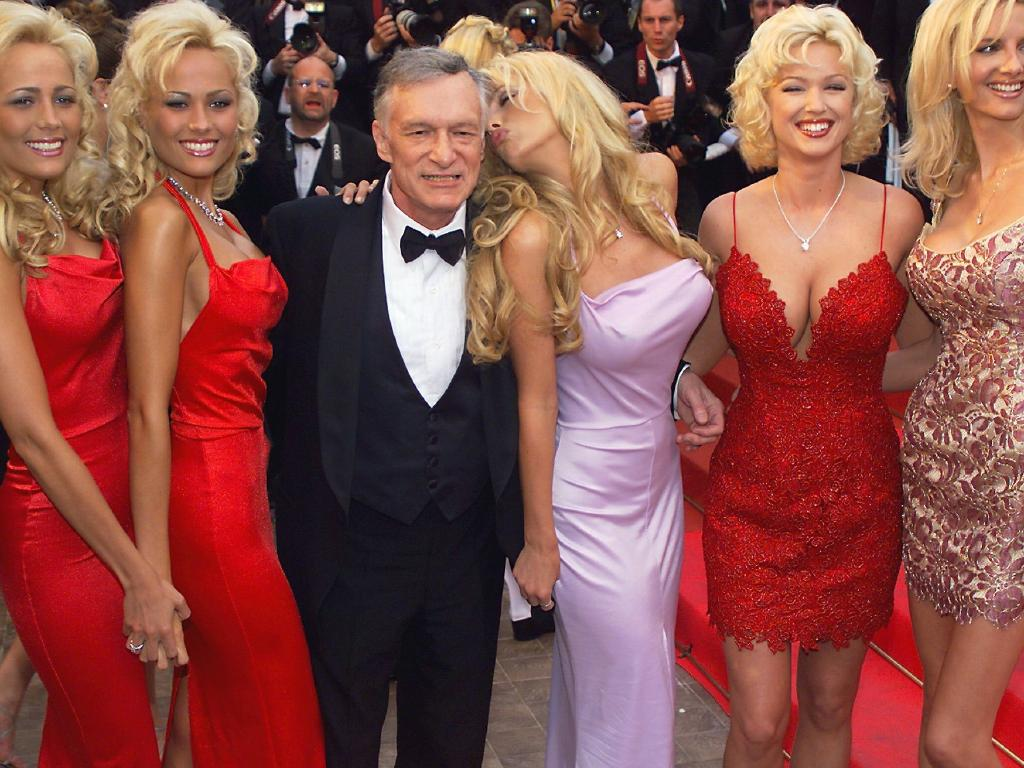 Playboy magazine president Hugh Hefner poses with playmates. He allegedly destroyed a cement chest of incriminating A-list sex tapes before his death. Picture: Supplied