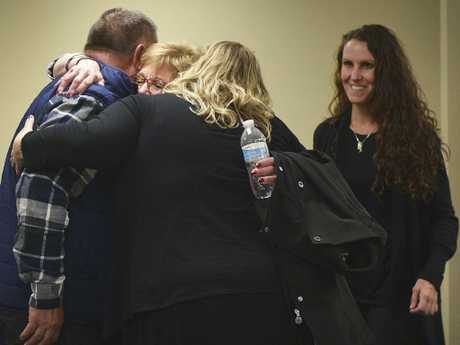 Lynette Johnson, widow of the prison officer Berget beat to death, hugs family with daughter Toni Schafter, right, after the execution. Picture: Briana Sanchez.
