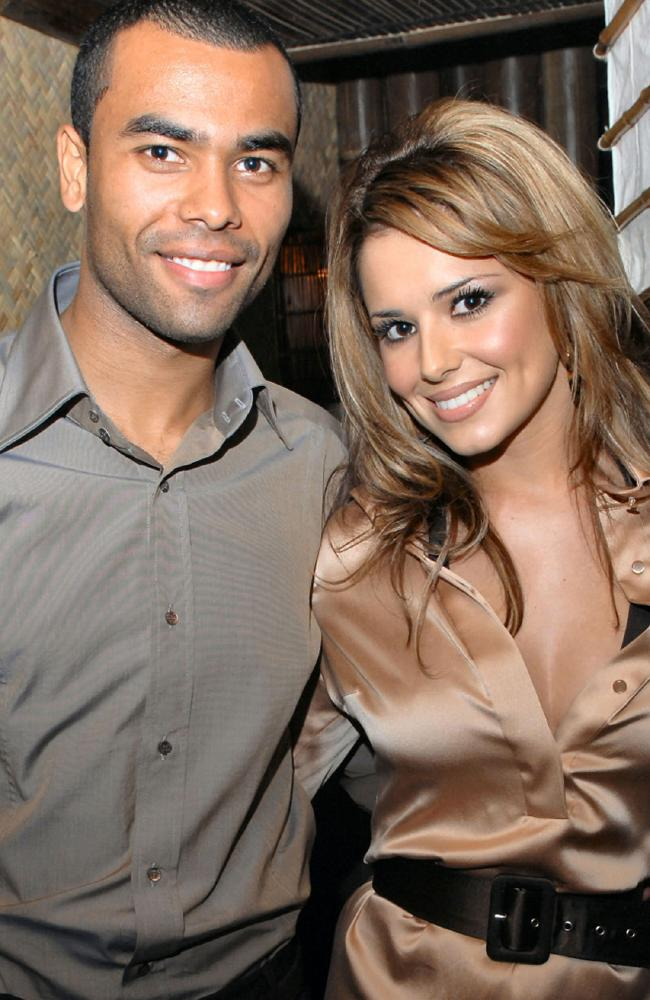 With first husband Ashley Cole.