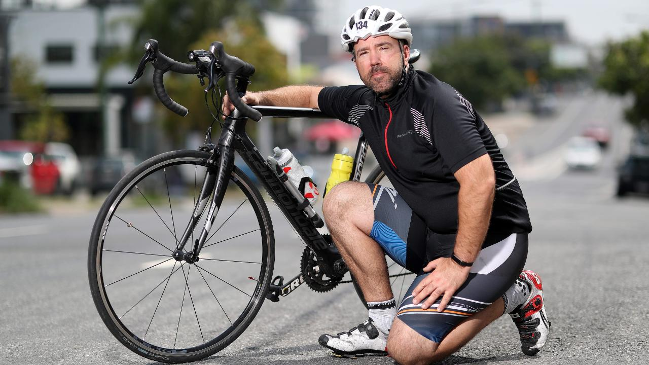 Matthew Coley, who was struck by a hit and run car on Kelvin Grove Rd in 2004, is regularly riding a road bike again. Picture: Peter Wallis