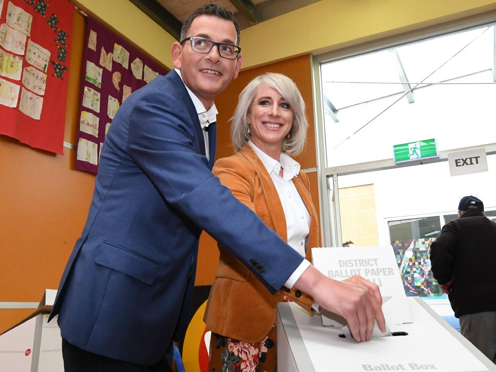 Daniel Andrews and wife Catherine vote in Mulgrave on Saturday, the premier saying he will campaign on till booths shut at 6pm. Picture: Julian Smith.