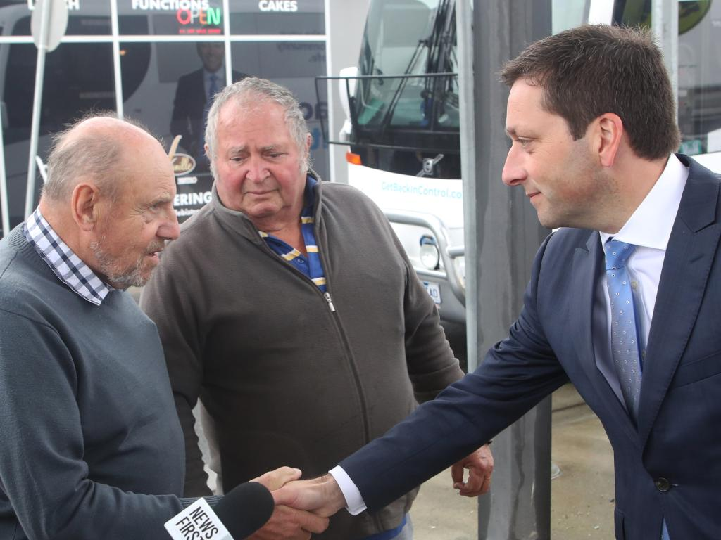 Opposition Leader Matthew Guy talks to locals in Pakenham, Melbourne on the campaign's last day. Picture: David Crosling.