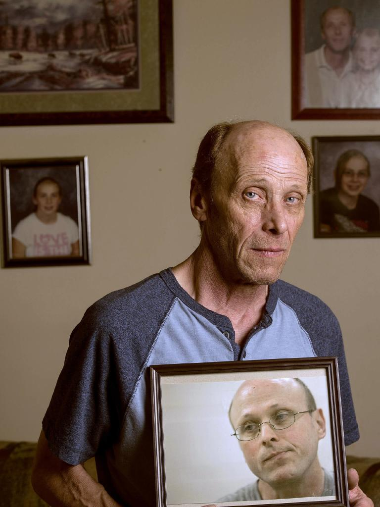 David Moore and a photo of executed brother Carey. Picture: Eric Gregory.