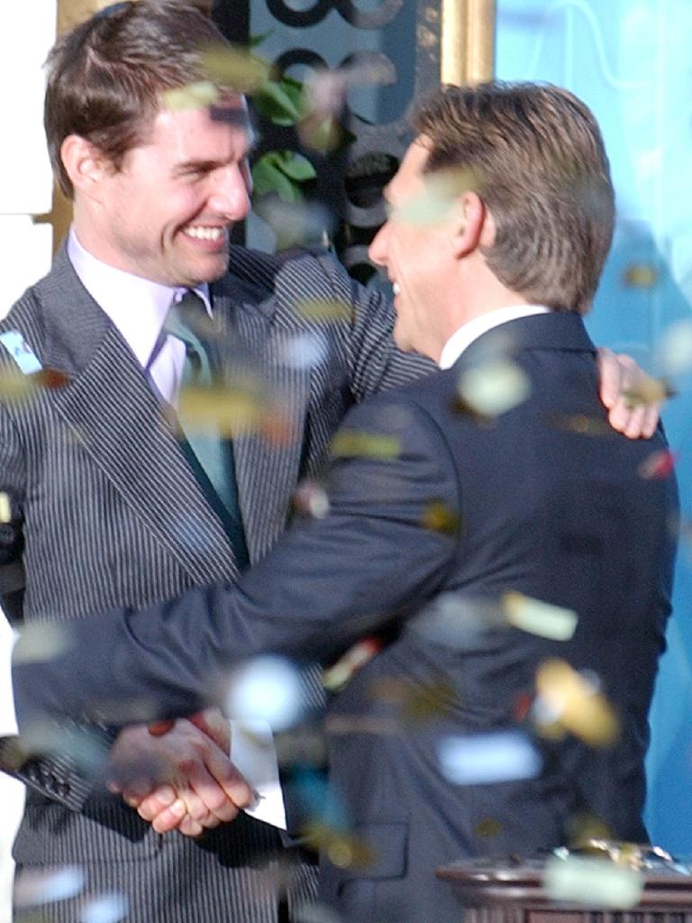 Tom Cruise embraces David Miscavige in 2004. Picture: Paul White.